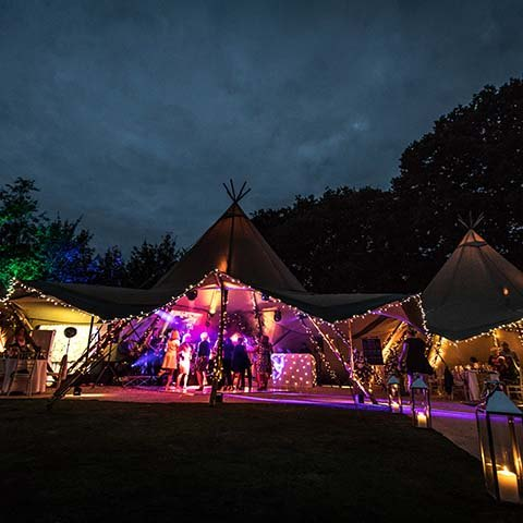 Tipi marquee with fairy lights at 50th Wedding anniversary in Surrey