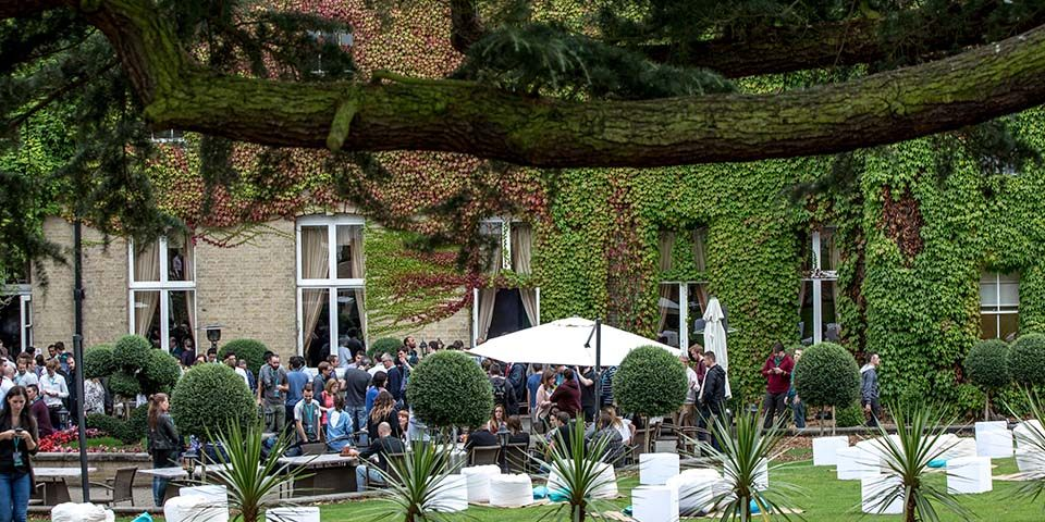 Event management corporate away day delegates in seated outdoor space