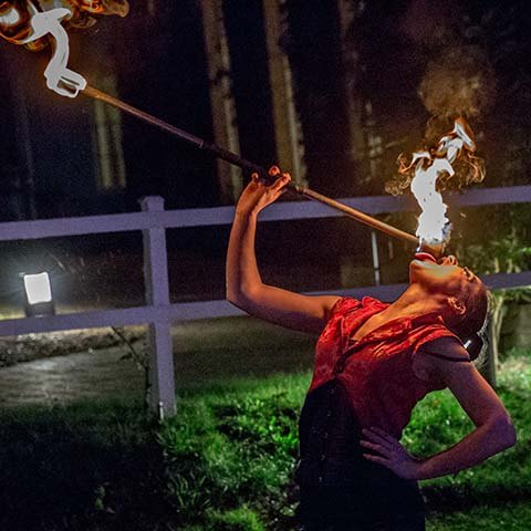 Event management travel themed corporate away day entertainment fire breather and flame eater