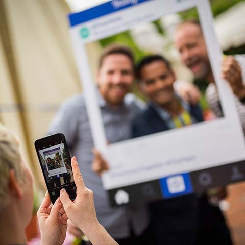 guests taking photos via an instagram photo frame