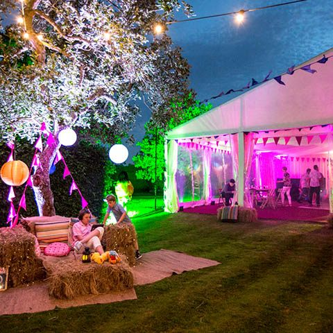 Party planner family garden party hay bales and festoon lighting