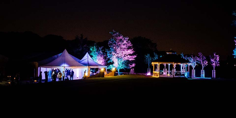 Twins 18th birthday party planners marquee and garden uplighters