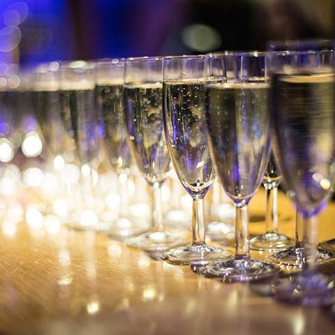 Champagne drinks reception at surprise birthday party in Surrey